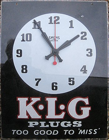 K.L.G. PLUGS GLASS CLOCK - click to enlarge